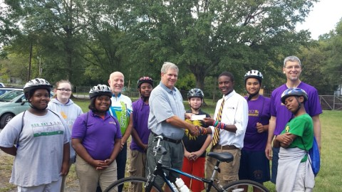 Spinners Present $2,450 Check to Momemtum Bike Club of Greenville