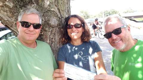 Steve Yetman with Ken Drescher present a Greenville Spinners check to Joelle Teachey, Executive Director of TreesGreenville
